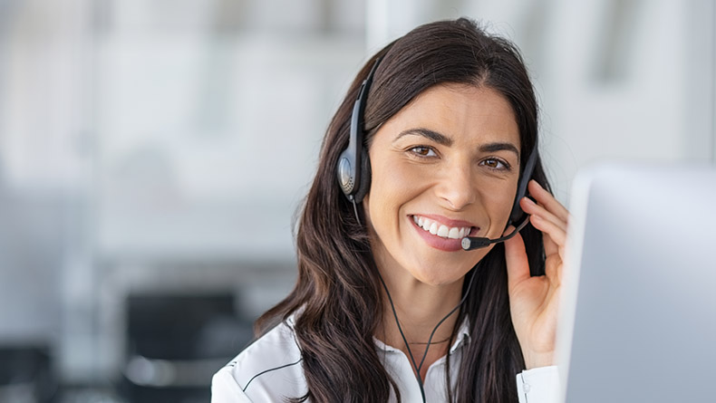 smiling woman wearing headset and micophone