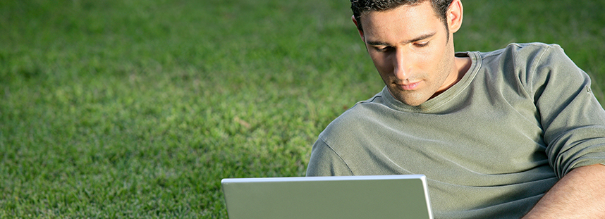 guy on lawn with laptop