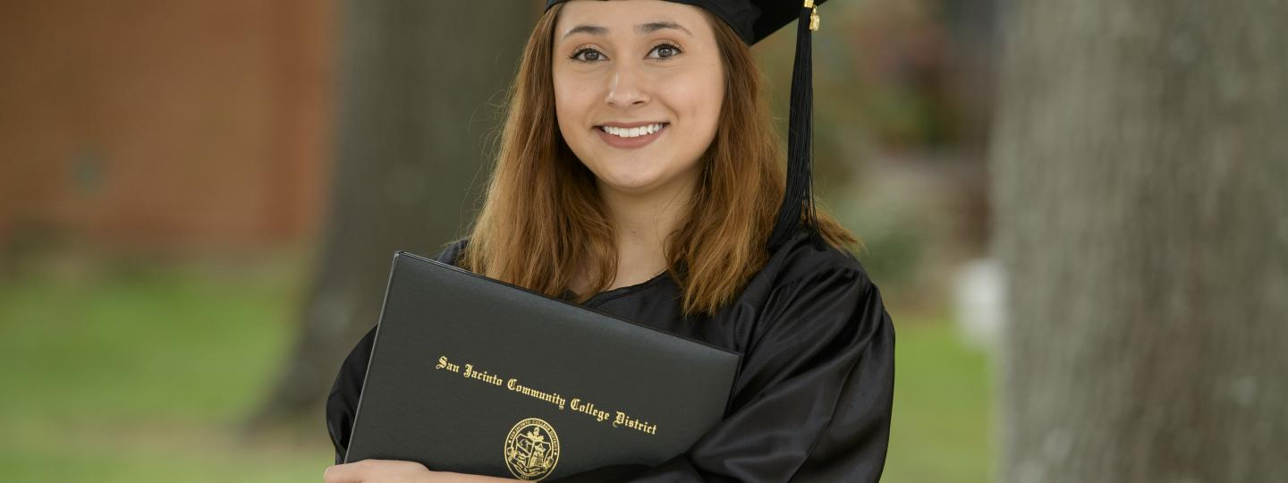 female student in cap and gown