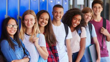 High school students standing by lockers