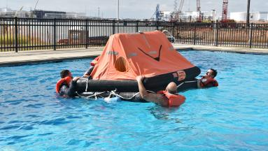 Maritime students practicing operations in a pool