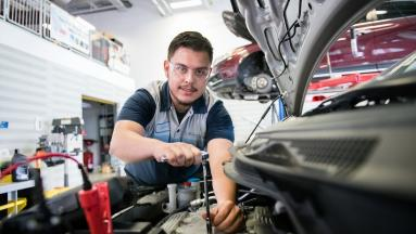 Honda automotive student working on engine