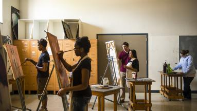 Painting students in art studio