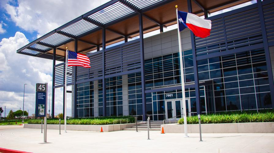 entry to CPET building featuring flags for US and Texas